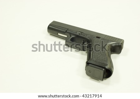 pistol isolated over a white background (close up) - stock photo