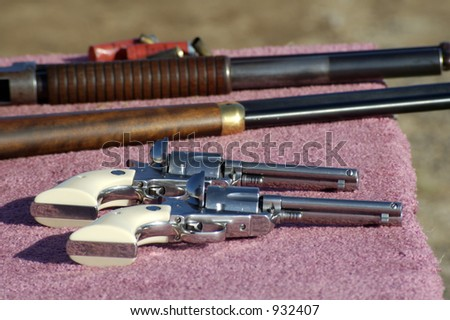 Pistols, rifle and shotgun ready for a safety check at a cowboy shooting competition.