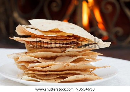 pita bread on a background of fire - stock photo