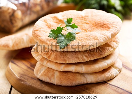 pita bread on wooden board Stockfoto ©