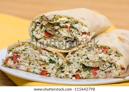 Pita bread wrapped with cottage cheese and vegetables