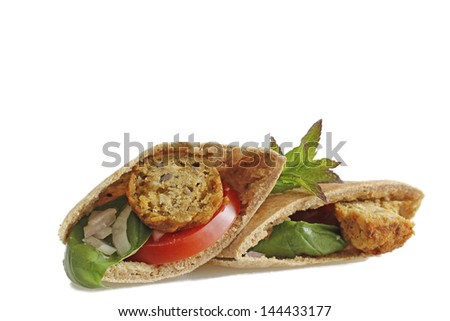 Pita with falafel with tomato and black olives