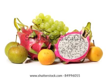 pitaya and grapes on white background - stock photo