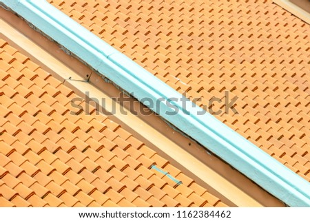 pitched roof tiles in repetitive patterns, old architecture shophouses Singapore Asia #1162384462