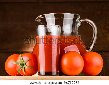pitcher and glass of tomato juice - stock photo