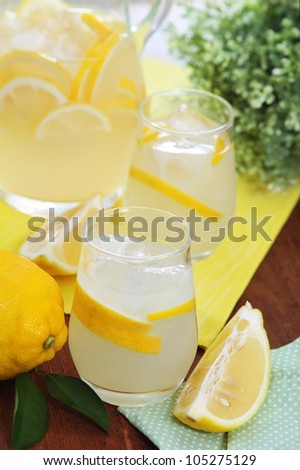 Pitcher and glasses of fresh lemonade on the table