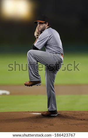 Pitcher Baseball Player on a Orange Uniform on baseball Stadium.