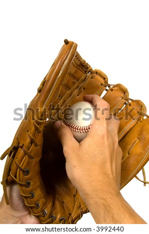 Pitcher holding baseball in glove againsy white background