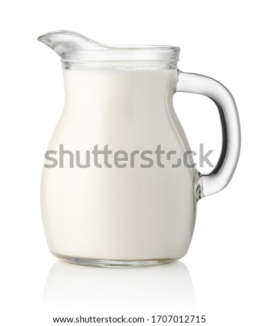 Pitcher of milk isolated on white background. Clipping path. Glass jug