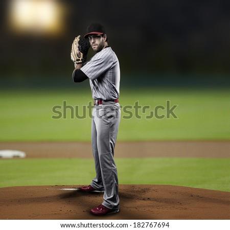 Pitcher  Player throwing a ball, on a baseball Stadium.