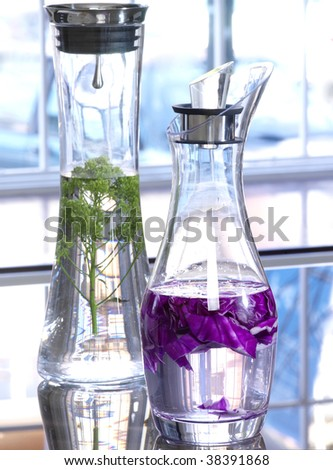 Pitchers with water and vegetables in the kitchen(cuisine)