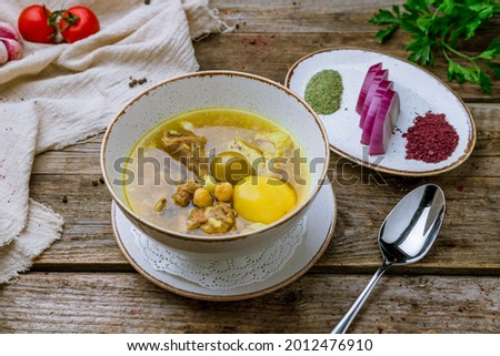 Piti soup with lamb, potatoes and red onion on old wooden table Stock photo ©