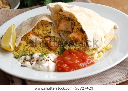 Pitta bread stuffed with couscous and chicken