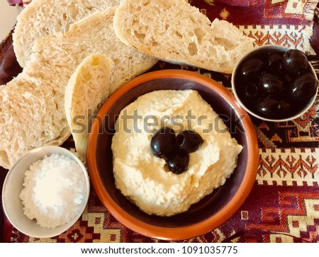 Pitta with houmous, olives and rustic bread #1091035775