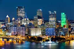 Pittsburgh downtown skyline by night. Located at the confluence of the Allegheny, Monongahela and Ohio rivers, Pittsburgh is also known as