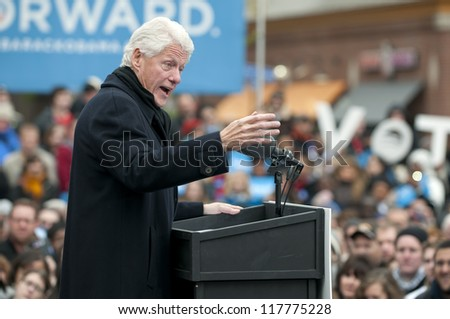 PITTSBURGH, PA - NOVEMBER 5:  Former President Bill Clinton campaigns for Barack Obama on the eve of the election at Market Square in Pittsburgh, PA on November 5, 2012. - stock photo