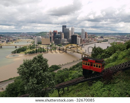 Pittsburgh Pennsylvania river view, incline railroad and skyline with storm clouds.