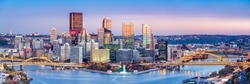 Pittsburgh, Pennsylvania skyline at dusk. Located at the confluence of the Allegheny, Monongahela and Ohio rivers, Pittsburgh is also known as