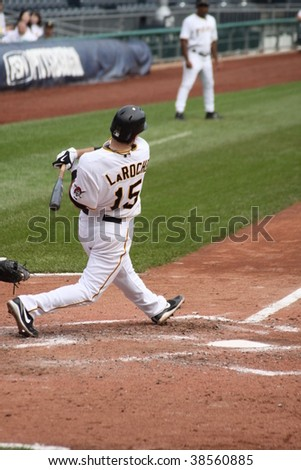 PITTSBURGH - SEPTEMBER 24 : Andy LaRoche of Pittsburgh Pirates swings at a pitch against Cincinnati Reds on September 24, 2009 in Pittsburgh, PA.