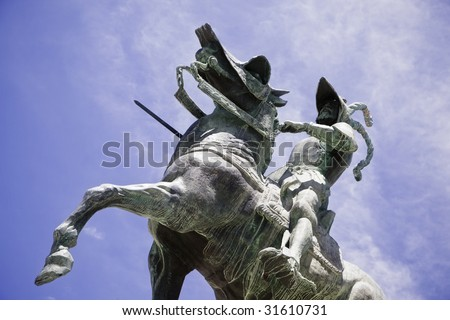stock photo : Pizarro statue over the blue sky.