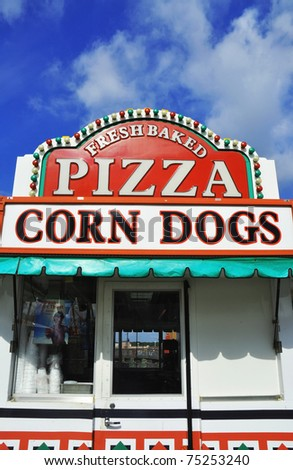 Pizza and Corn Dog sign at a fairgrounds