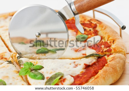 pizza and cutter close up