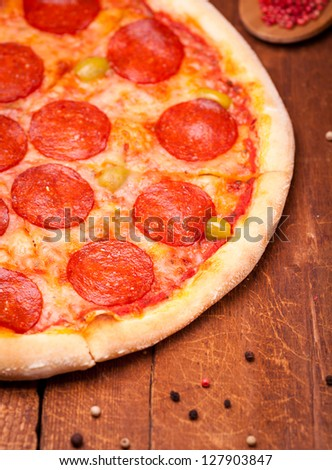 pizza and spices on wooden table