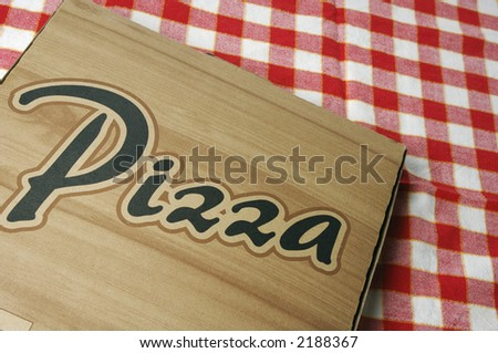 pizza box against red/white cloth