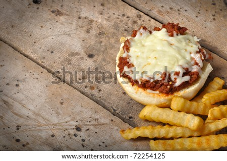 Pizza Burger with French Fries on old vintage wood table with copy space