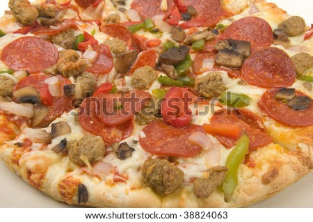 Pizza close up with lots of toppings - stock photo