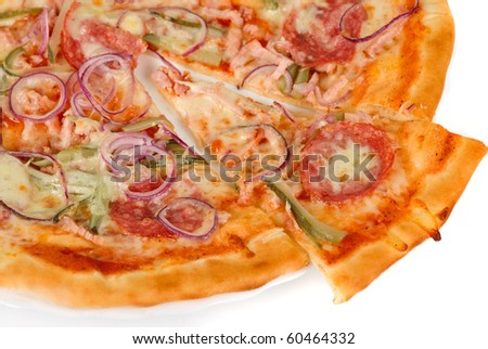 pizza closeup with smoked meat, salami, gherkin, onion and mozzarella cheese
