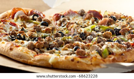 Pizza closeup with supreme toppings