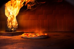 Pizza Cooking in a Brick Oven Pizza Furnace