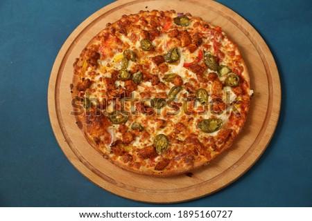 pizza covered with natural products, made from thin doughSiyah taş arka plan üzerinde Pizza Margherita. Domates, fesleğen ve Mozzarella peyniri ile ev yapımı pizza Margarita.  Stok fotoğraf ©