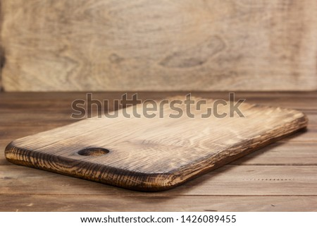 pizza cutting board at rustic wooden table in front