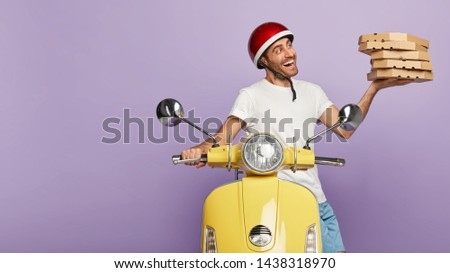 Pizza delivery man carries stack of boxes, works on scooter, conveys fast food from restaurant for customers, wears casual neat clothes, headgear, isolated on purple background. Take your order