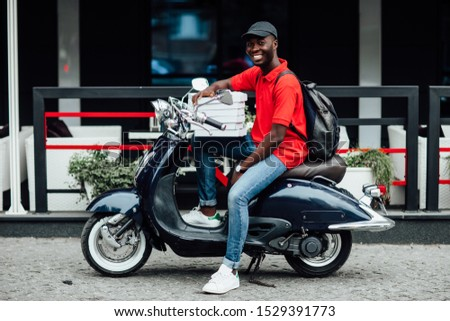 Pizza delivery man carries stack of boxes, works on scooter, conveys fast food from restaurant for customers, wears casual neat clothes, headgear, isolated on purple background. Take your order.