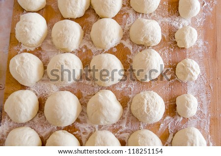 pizza dough risen and ready for cooking - stock photo