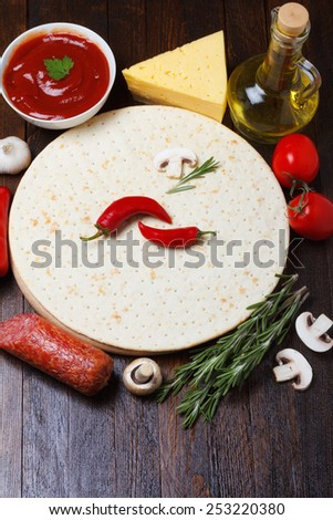 Pizza dough with different ingredients for cooking