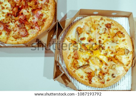 Pizza in delivery box #1087193792