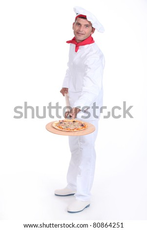 Pizza maker showing off his pizza