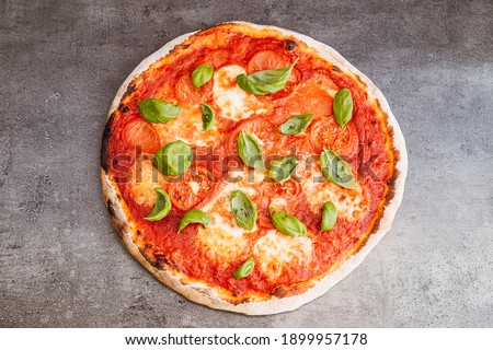 Pizza margherita on dark background. Traditional italian pizza, top view. Takeaway food