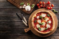 Pizza Napoletana - Napoli tomato sauce mozzarella and basil - top of view.