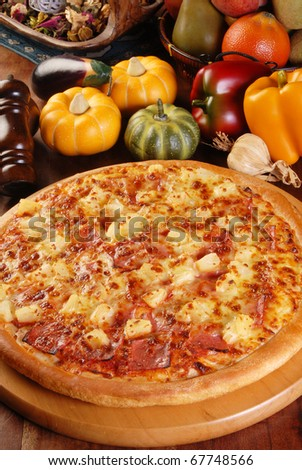 Pizza on the brown wood table - stock photo