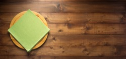 pizza or bread cutting board and napkin cloth at wooden table, top view