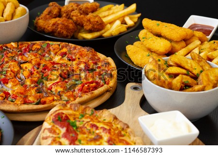 Pizza pasta and more dishes on the table #1146587393