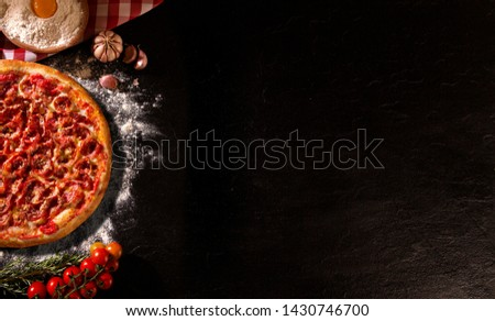 Pizza pepperoni on wood background. Top view, close up. Traditional Brazilian Pizza