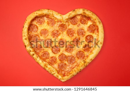 Pizza shaped heart top view Valentine's Day on red background. #1291646845