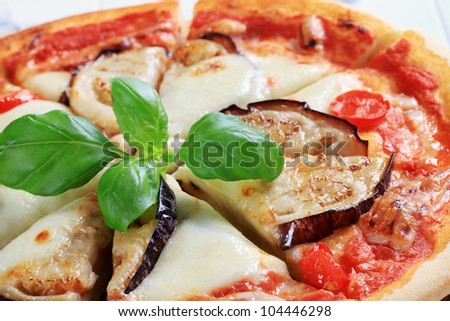Pizza topped with cheese and slices of eggplant