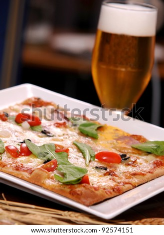 pizza with a glass of beer